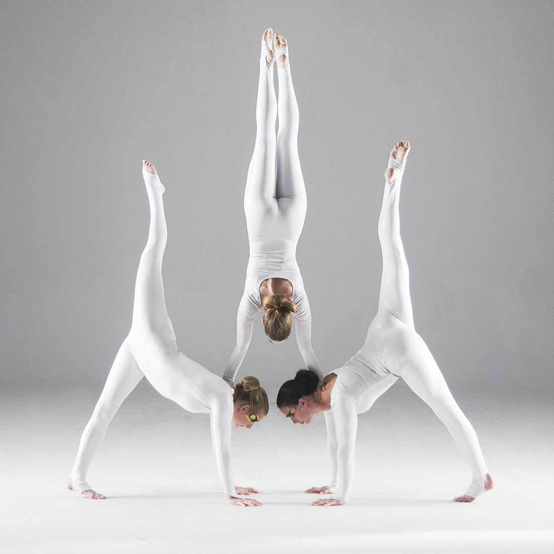 Groundbased Shows - Acrobats Gallery - All Girls Troupe in Corporate white costumes 1 3