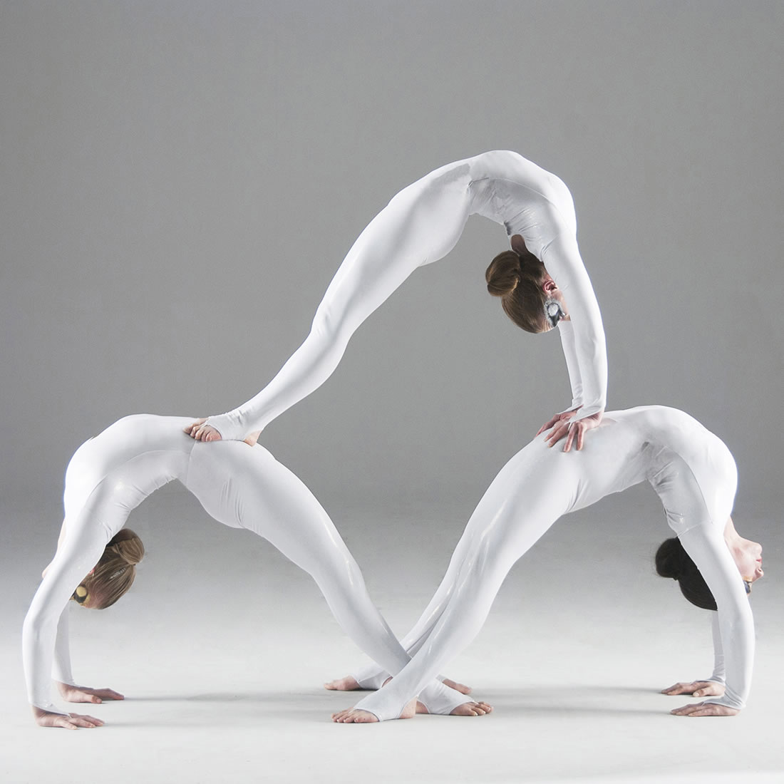 Groundbased Shows - Acrobats Gallery - All Girls Troupe in Corporate white costumes 1 5