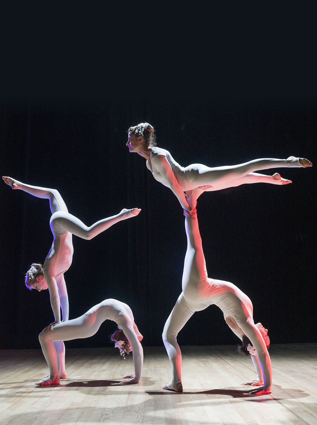 Groundbased Shows - Acrobats Gallery - All Girls Troupe in Corporate white costumes 1