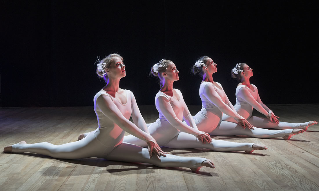 Groundbased Shows - Acrobats Gallery - All Girls Troupe in Corporate white costumes 2