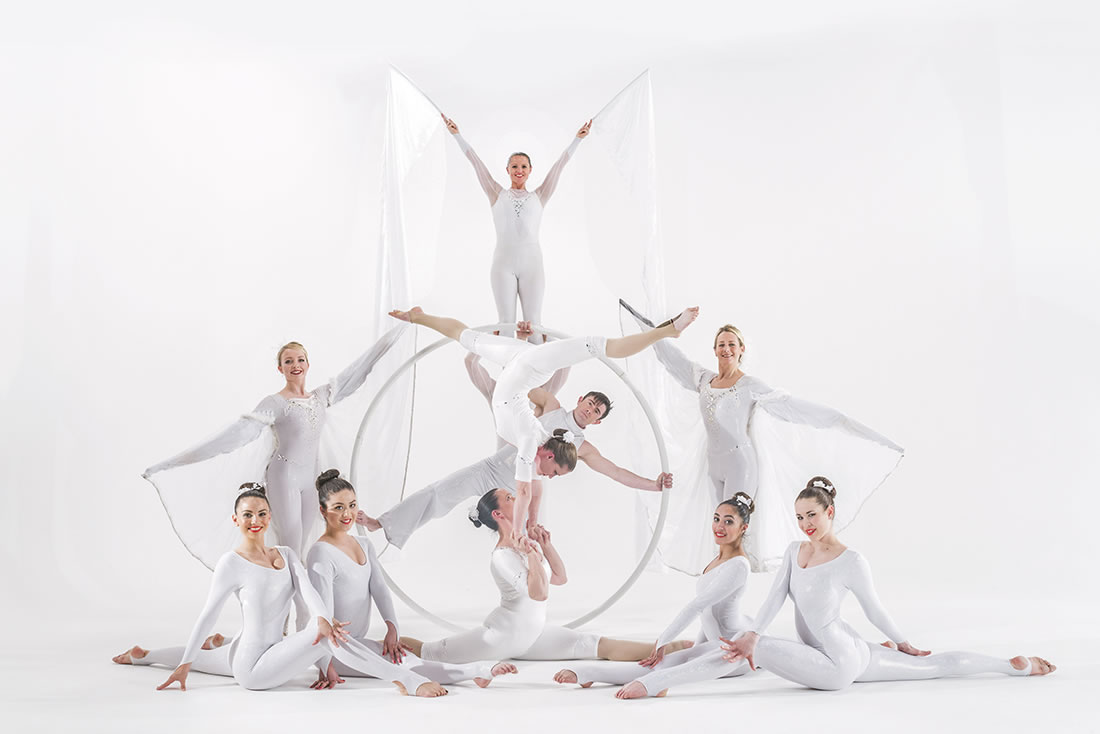 Large Cirque Shows - Hero - Corporate white with silks flags