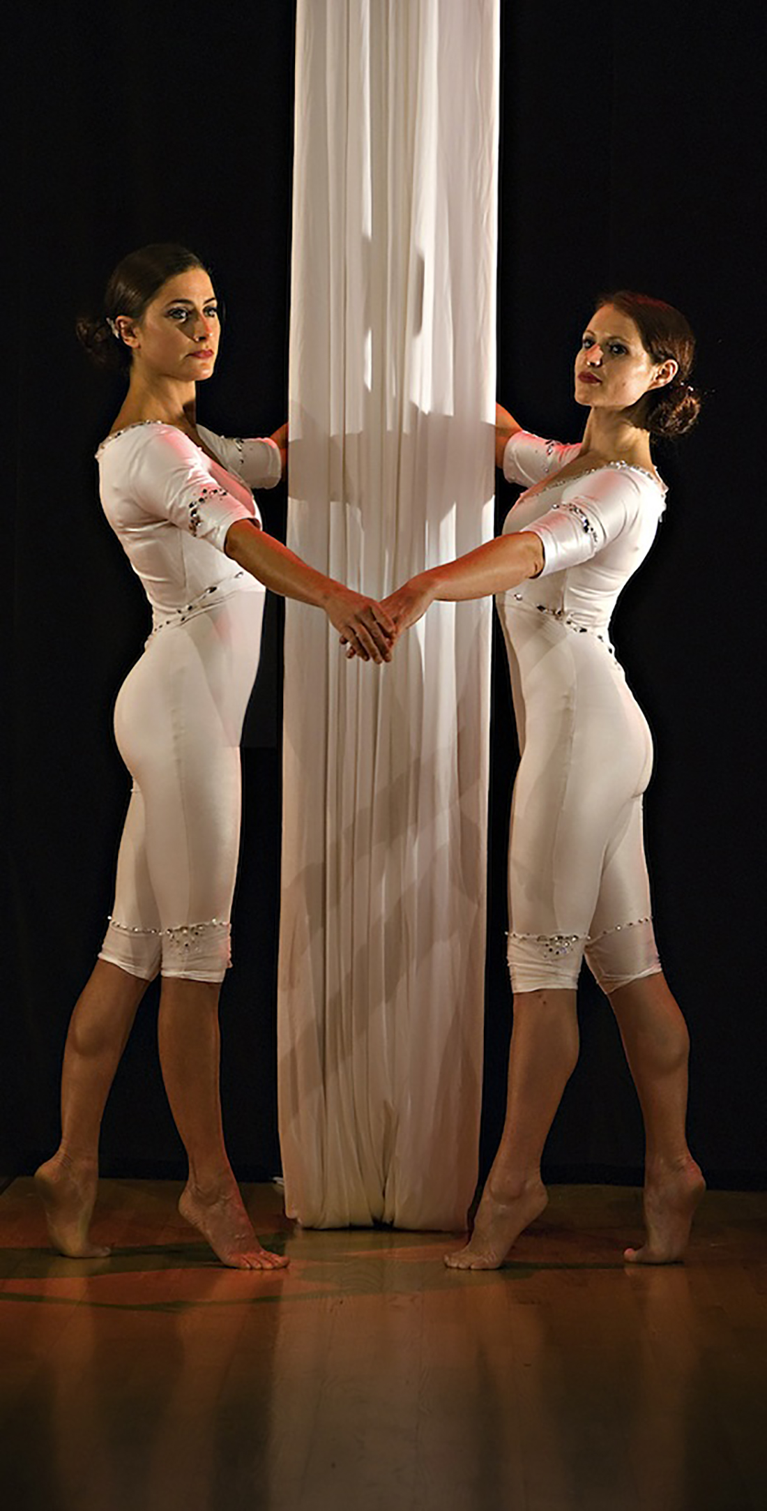 White mid length catsuits with crystals